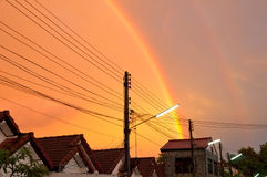 Double rainbow at color gold sky. Stock Photos