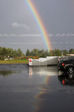 Double rainbow and its reflection Stock Image