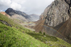 Double rainbow in mountains. Double rainbow in Altai mountains near Shavlinsky lakes Stock Photos