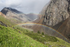 Double rainbow in mountains. Double rainbow in Altai mountains near Shavlinsky lakes Stock Images