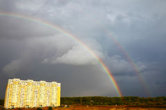 Double rainbow over building Stock Images