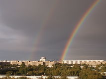Double rainbow over the city Royalty Free Stock Photography