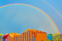 Double rainbow over the city Stock Images