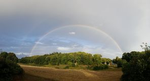 Double rainbow over forrest royalty free stock image
