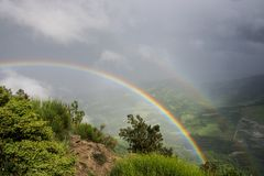 Double rainbow over hills Stock Images