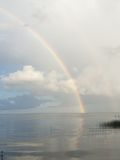 Double Rainbow over Lake with Clouds Stock Image