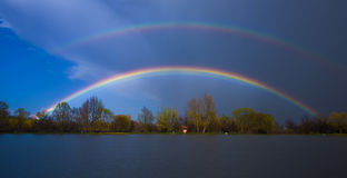 Double rainbow over the lake Royalty Free Stock Images