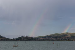 Double rainbow over the lake Royalty Free Stock Image