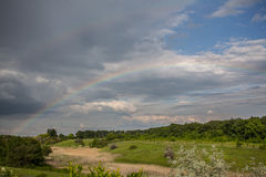 Double Rainbow. Over the meadow Stock Photo