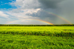 Double Rainbow over the meadow Stock Images