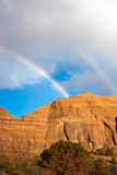 Double Rainbow over Monument Valley after a storm Stock Images
