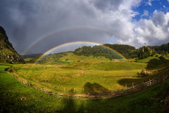 Double rainbow over the mountains. Romania, Fundatura Ponorului Royalty Free Stock Images