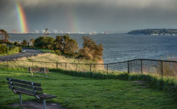 Double Rainbow over Puget Sound Waterway. The Rare Double Rainbow shows itself over the Puget Sound in Seattle, WA Royalty Free Stock Photography