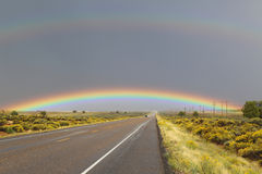 Double rainbow over the road Stock Image