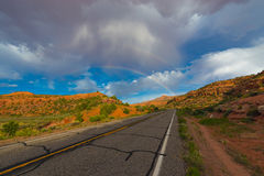 Double Rainbow over the road Stock Photo