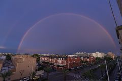 Double rainbow over the sky of the city of Elche in Spain. Stock Image