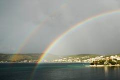 Double rainbow over the small town. Double rainbow - Razanj, Croatia Stock Photo