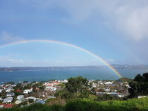 Double rainbow over the town. Double rainbows appearing after a light rain over town Stock Images