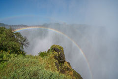 Double rainbow over Victoria Falls in spray Royalty Free Stock Image