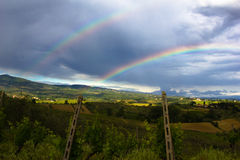 Double Rainbow over Vineyard. Shot taken after a spring thunderstorm in a chianti vineyard, Tuscany, Italy royalty free stock images