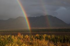 Double rainbow on Parks Highway in Alaska stock images