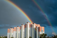 Double Rainbow. After rain above the multi-storey house Royalty Free Stock Photo