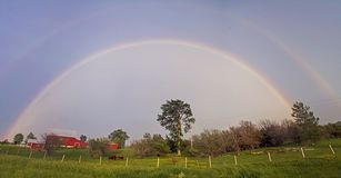 Double Rainbow with red barn Stock Photo