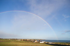 Double Rainbow in rural Irish Countryside ending in the Irish Se royalty free stock images