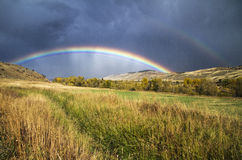 Double rainbow. A double rainbow we saw in the fall after a storm across a hay field stock photography