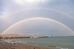 Double rainbow on sea beach Royalty Free Stock Images