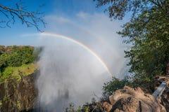 Double rainbow in spray at Victoria Falls Stock Photos