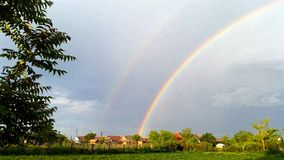 Double rainbow. Rainbow storm green Royalty Free Stock Photo