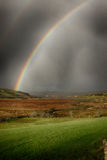 Double rainbow during a storm in Ireland Royalty Free Stock Images