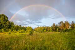 Double rainbow, sunny day landscape. Double rainbow, summer forest and field Stock Images