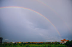 Double rainbow. After thunderstorm over village Stock Image