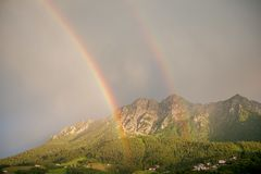 After the thunderstorm. Double rainbow After the thunderstorm Stock Images