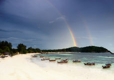 Double rainbow on a tropical beach Stock Images
