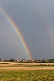 Double Rainbow in Village Landscape Royalty Free Stock Images