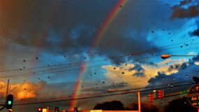 Double Rainbows and Raindrops at Intersection royalty free stock photography