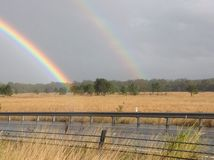 Double Real Rainbow over Field Royalty Free Stock Photography