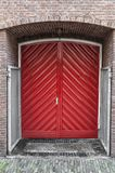 Double red door built into a wall royalty free stock photo