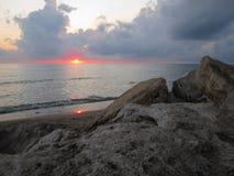 Double red sun. A particular sun set in a italian beach royalty free stock photos