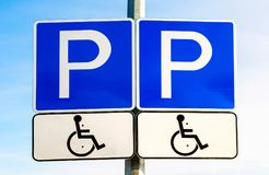 Double road sign Parking place for the disabled Stock Images