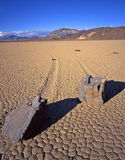 Double Rock Trails (V). Two rocks and the trails left behind, on the Racetrack Playa in Death Valley National Park, California Stock Image