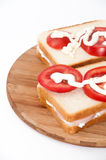Double sandwich with sour cream tomato and salami Stock Image
