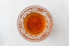 Double scotch from above. A glass containing a double scotch with no ice, from above Royalty Free Stock Image
