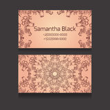 Double-sided  business card with a tribal floral pattern Stock Photography