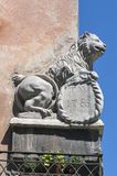 Double-sided split statue of a lion on the house corner Royalty Free Stock Images