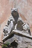 Double-sided split statue of a lion on the house corner Royalty Free Stock Image