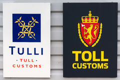Double sign of customs at border between Finland and Norway.